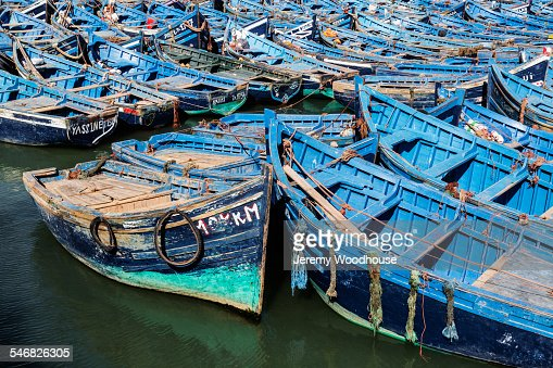 High angle view of dilapidated boats floating in bay