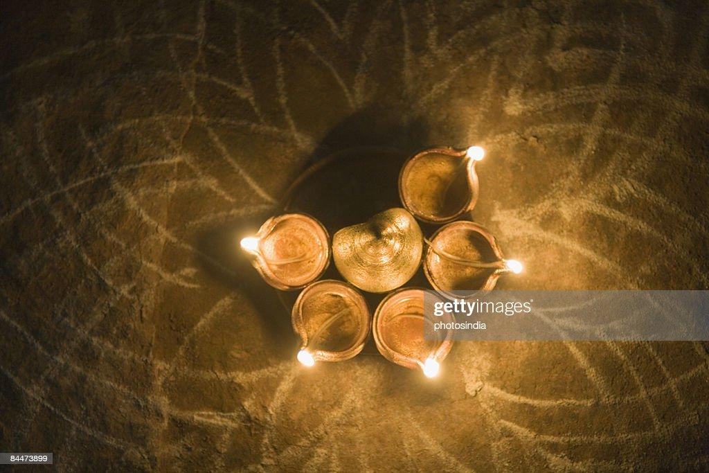High angle view of diwali lamps