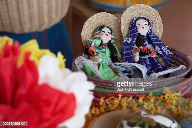 High angle view of dolls in a wicker basket