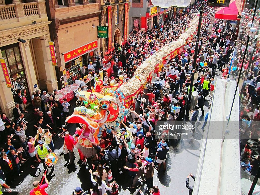 High Angle View Of Dragon Dancer On Street During Chinese New Year