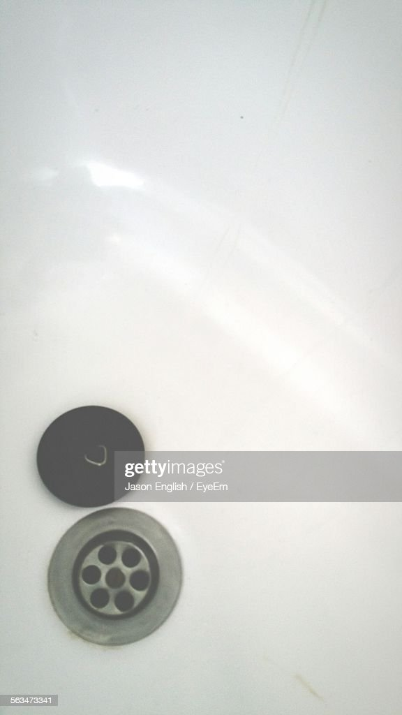 High Angle View Of Drain With Lid