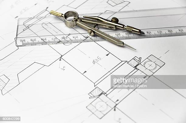 High Angle View Of Drawing Compass And Ruler On Diagram