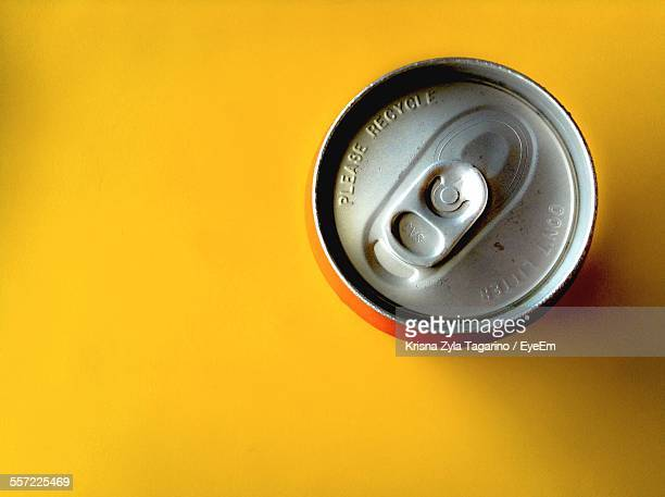High Angle View Of Drink Can On Yellow Table