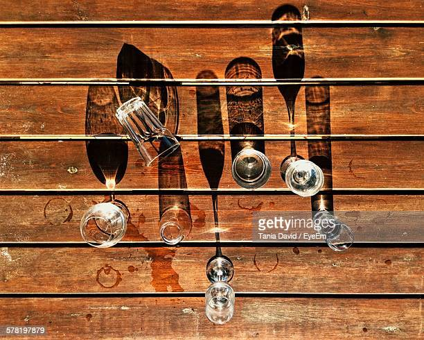 High Angle View Of Drinking Glasses On Wooden Table