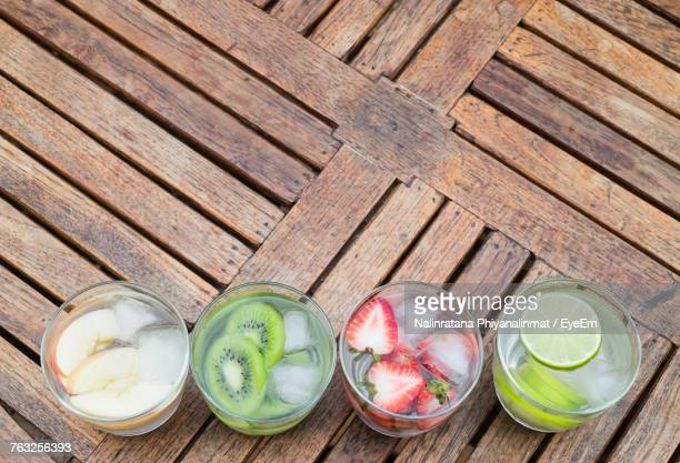 High Angle View Of Drinks On Wooden Table