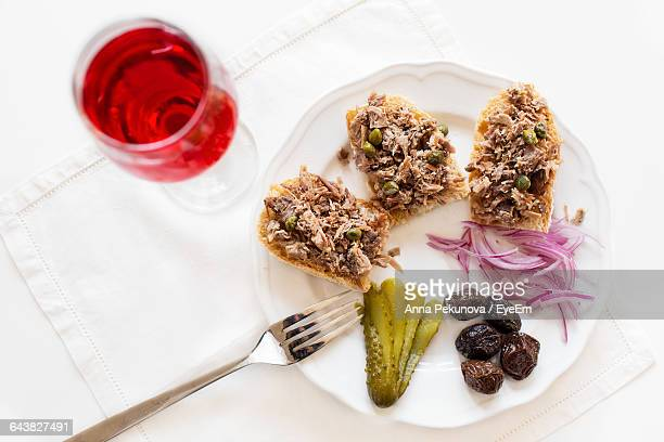 High Angle View Of Duck Rillettes Served With Red Wine On Table
