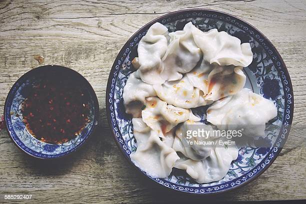 High Angle View Of Dumplings Served In Plate On Table