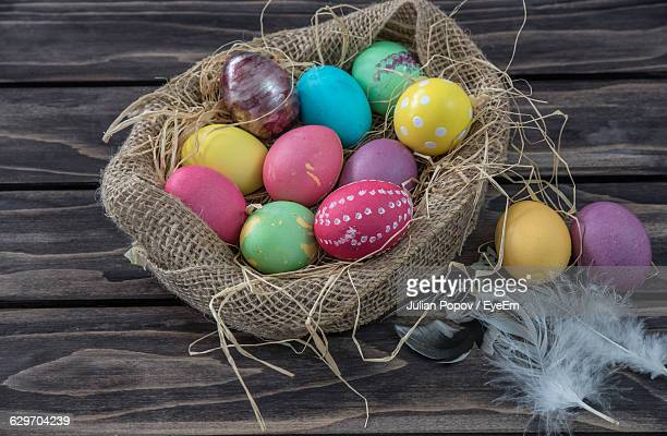 High Angle View Of Easter Eggs In Jute Sack On Table