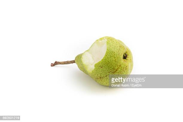 High Angle View Of Eaten Pear On White Background