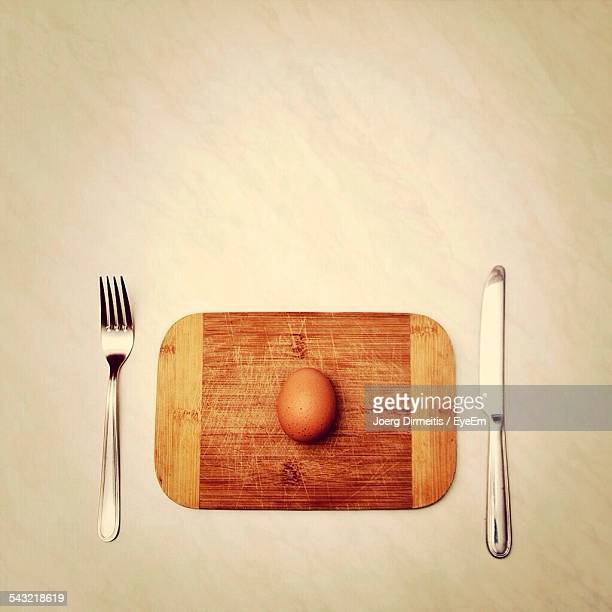 High Angle View Of Egg On Wooden Plate Served On Table