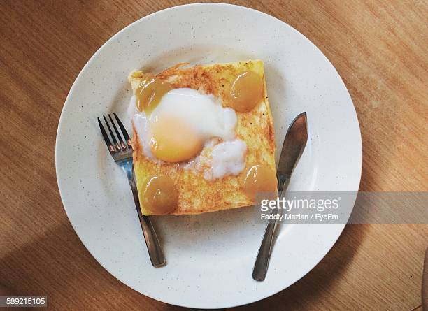 High Angle View Of Egg With Bread Served On Table