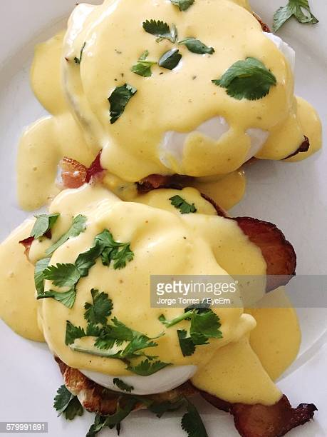 High Angle View Of Eggs Benedict On Plate
