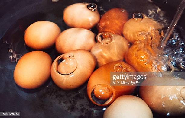 High Angle View Of Eggs Boiling In Cooking Pan