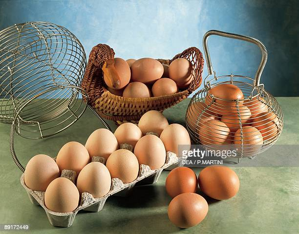 High angle view of eggs in baskets and a carton