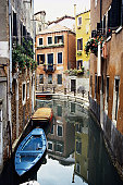 High angle view of empty boats in a canal, Venice, Italy