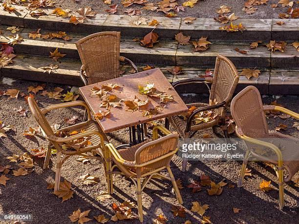 High Angle View Of Empty Chairs And Table At Sidewalk Cafe During Autumn