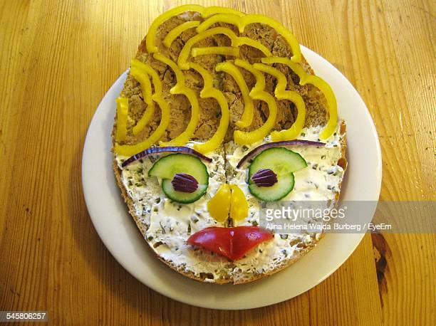 High Angle View Of Face Made On Sandwich