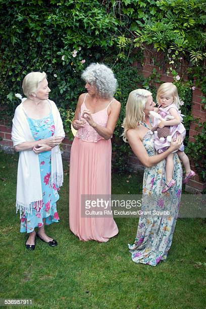High angle view of family of females with toddler daughter at garden party