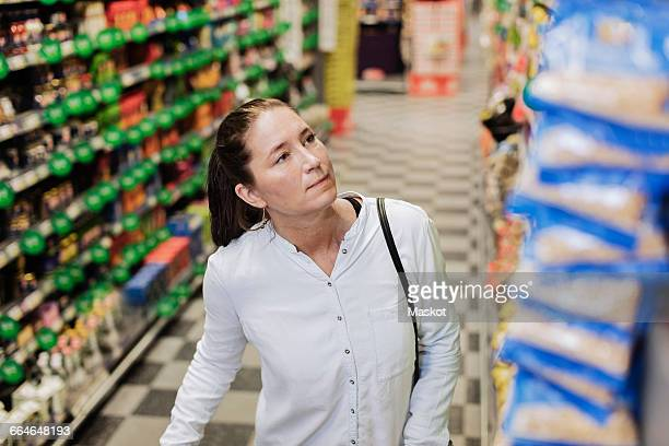 High angle view of female customer buying groceries in supermarket