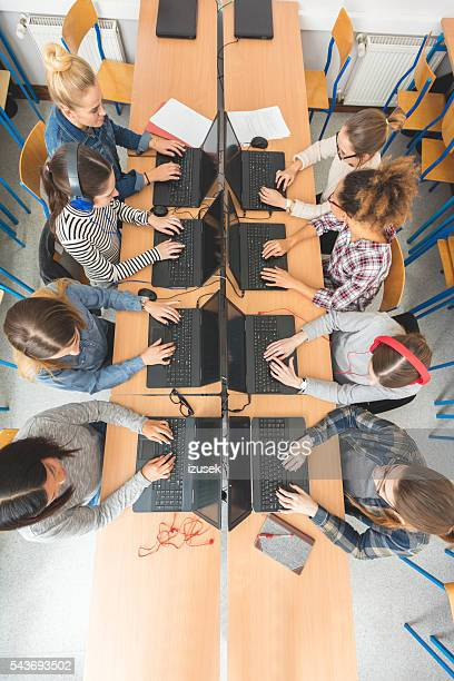 High angle view of female students coding
