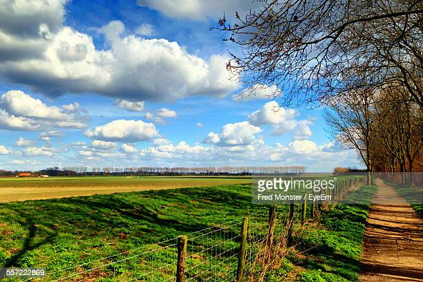 High Angle View Of Fence On Grassy Field
