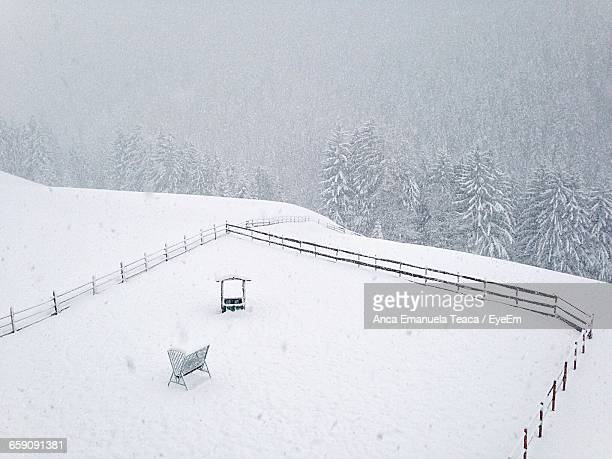 High Angle View Of Fence On Snow Covered Field