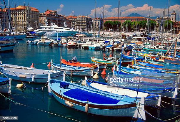 High angle view of fishing boats docked at a harbor, Nice, French Riviera, France