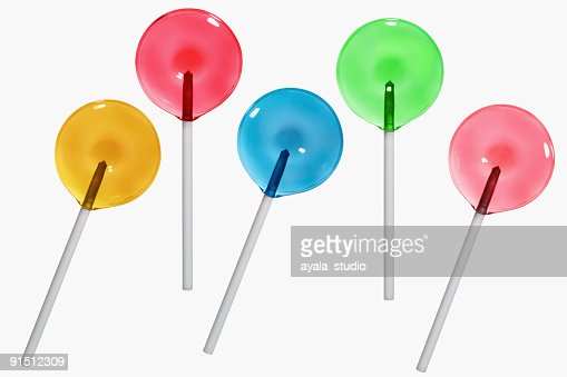 High angle view of five lollipops