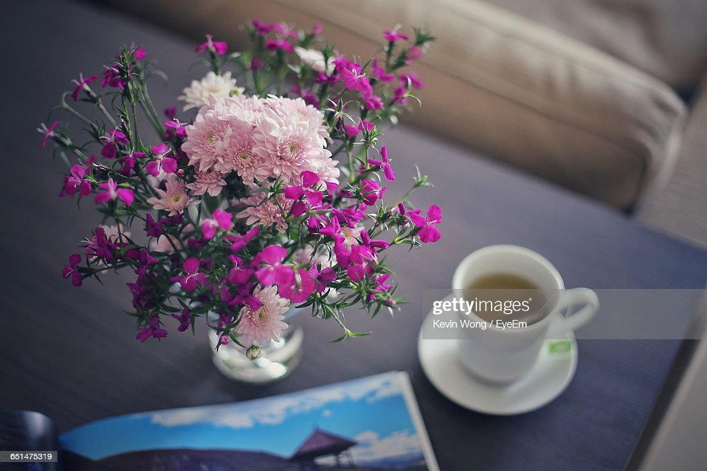 High Angle View Of Flower Vase And Tea Cup On Table At Home Stock