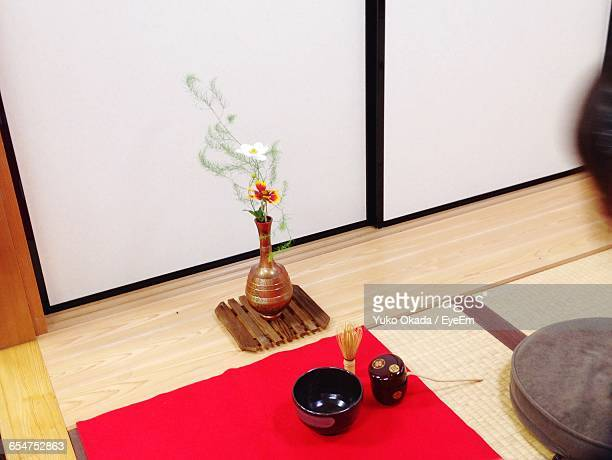 High Angle View Of Flowers By Tea Whisk With Bowl At Home