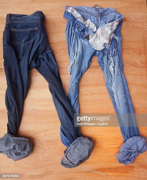 High Angle View Of Folded Jeans On Hardwood Floor