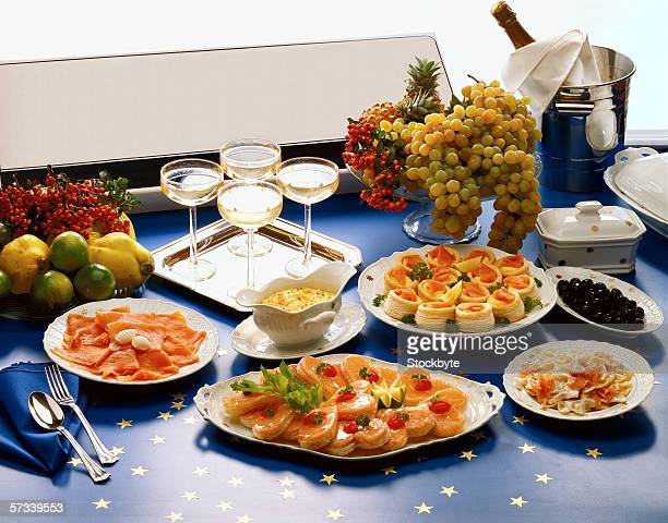 high angle view of food and wine laid out on a table