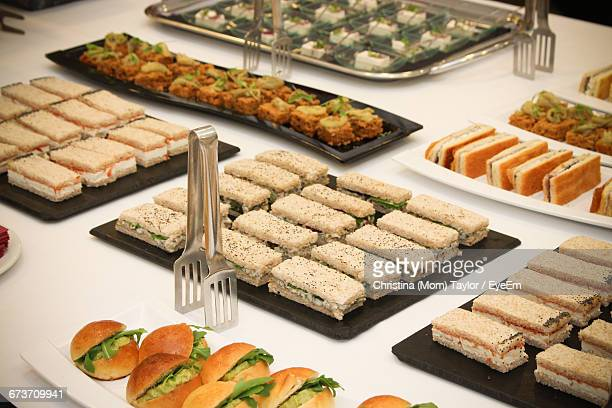 High Angle View Of Food Arranged In Plates On Table