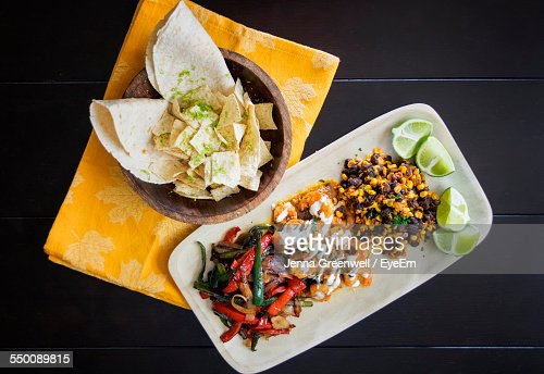 High Angle View Of Food Served On Table In Restaurant