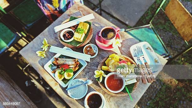 High Angle View Of Food Served On Table In Yard