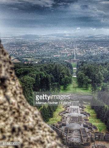 High Angle View Of Formal Garden Against City