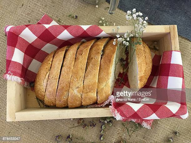 High Angle View Of Fresh Baked Bread In Wooden Container On Table