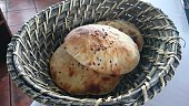 High Angle View Of Fresh Breads With Sesame Seeds In Basket