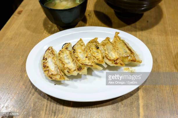 High Angle View Of Fresh Gyoza Served In Plate On Table At Restaurant