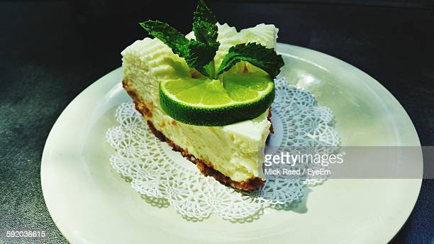 High Angle View Of Fresh Key Lime Pie Served In Plate