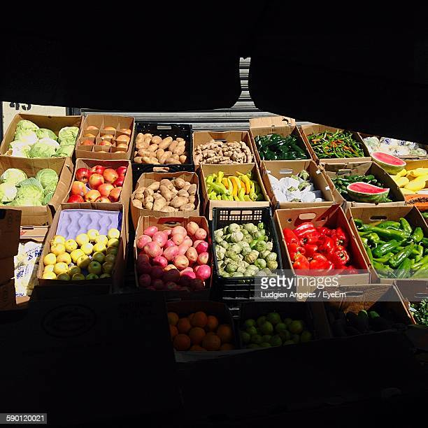 High Angle View Of Fresh Organic Vegetables At Market Stall In Sunlight
