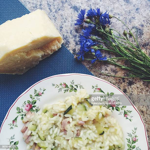 High Angle View Of Fresh Risotto In Plate With Parmesan Cheese