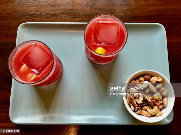 High Angle View Of Fresh Strawberry Cocktails With Nuts In Bowl Served On Tray