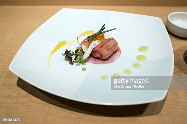 High Angle View Of Fresh Tuna Meat Served In Plate On Table
