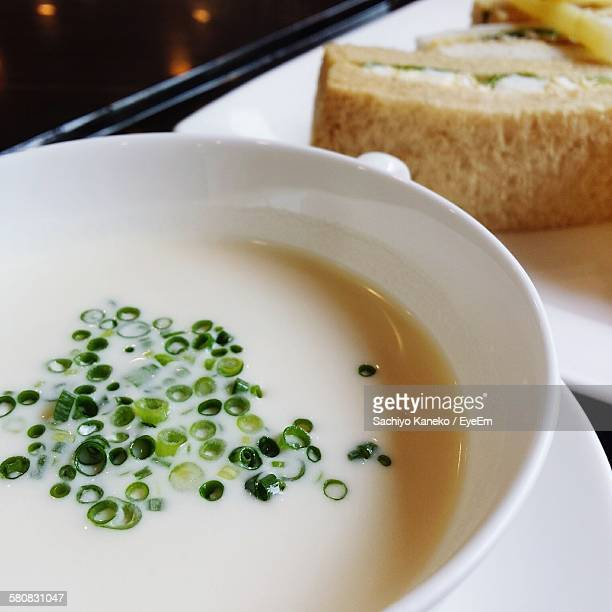 High Angle View Of Fresh Vichyssoise With Sandwich On Table
