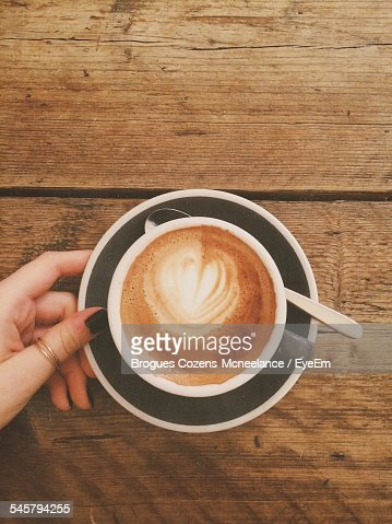 High Angle View Of Froth Art On Cappuccino