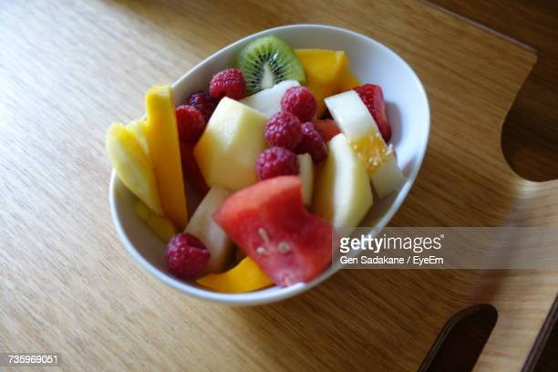 High Angle View Of Fruit Salad In Bowl On Wooden Tray