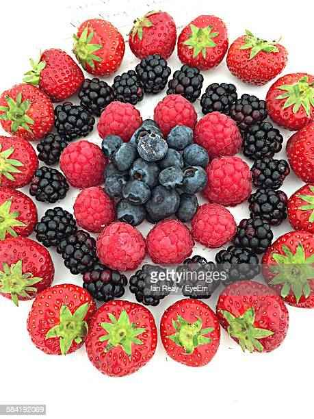 High Angle View Of Fruits Arranged Over White Background
