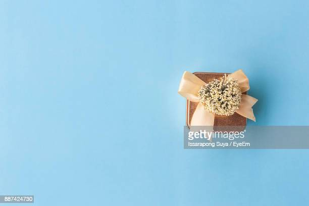 High Angle View Of Gift Box On Blue Background