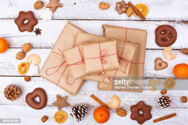 High Angle View Of Gifts Amidst Cookies On Table